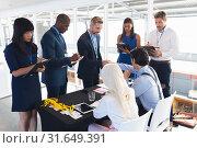 Купить «Business people checking in at conference registration table», фото № 31649391, снято 16 марта 2019 г. (c) Wavebreak Media / Фотобанк Лори