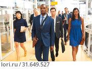 Купить «Business people walking together in the corridor at office», фото № 31649527, снято 16 марта 2019 г. (c) Wavebreak Media / Фотобанк Лори