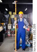 Купить «working man practicing his skills erect trestle at workshop», фото № 31650399, снято 17 января 2017 г. (c) Яков Филимонов / Фотобанк Лори