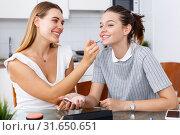 Two girls applying make up. Стоковое фото, фотограф Яков Филимонов / Фотобанк Лори