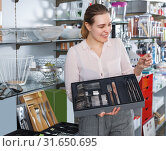 Купить «female choose flatware», фото № 31650695, снято 2 мая 2018 г. (c) Яков Филимонов / Фотобанк Лори
