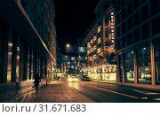 Купить «Geneva city at night, Rue du Rhone», фото № 31671683, снято 24 ноября 2016 г. (c) EugeneSergeev / Фотобанк Лори