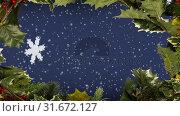 Купить «Christmas holly border and snowflakes», видеоролик № 31672127, снято 24 сентября 2018 г. (c) Wavebreak Media / Фотобанк Лори