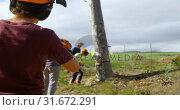 Купить «Lumberjack examining the tree trunk before cutting», видеоролик № 31672291, снято 13 августа 2018 г. (c) Wavebreak Media / Фотобанк Лори