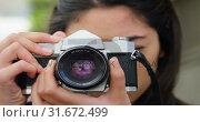 Купить «Woman clicking photo with digital camera 4k», видеоролик № 31672499, снято 23 августа 2018 г. (c) Wavebreak Media / Фотобанк Лори