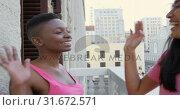 Купить «Women giving hi five in balcony at home 4k», видеоролик № 31672571, снято 29 августа 2018 г. (c) Wavebreak Media / Фотобанк Лори
