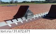 Купить «Close-up of starting blocks on a running track 4k», видеоролик № 31672671, снято 17 апреля 2018 г. (c) Wavebreak Media / Фотобанк Лори