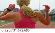 Купить «Rear view of Caucasian female athlete standing on a race track 4k», видеоролик № 31672695, снято 17 апреля 2018 г. (c) Wavebreak Media / Фотобанк Лори