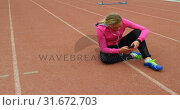 Купить «Front view of Caucasian female athlete listening music on mobile phone at sports venue 4k», видеоролик № 31672703, снято 17 апреля 2018 г. (c) Wavebreak Media / Фотобанк Лори