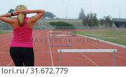 Купить «Rear view of Caucasian female athlete walking on running track 4k», видеоролик № 31672779, снято 17 апреля 2018 г. (c) Wavebreak Media / Фотобанк Лори