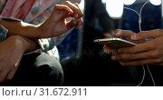 Купить «Commuters using mobile phone while travelling in bus 4k», видеоролик № 31672911, снято 10 июня 2018 г. (c) Wavebreak Media / Фотобанк Лори