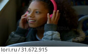 Купить «Girl listening music on headphones while travelling in bus 4k», видеоролик № 31672915, снято 10 июня 2018 г. (c) Wavebreak Media / Фотобанк Лори