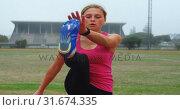 Купить «Front view of Caucasian female athlete exercising on race track 4k», видеоролик № 31674335, снято 17 апреля 2018 г. (c) Wavebreak Media / Фотобанк Лори