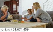 Купить «Multi-generation family playing board game in living room 4k», видеоролик № 31674459, снято 24 августа 2018 г. (c) Wavebreak Media / Фотобанк Лори