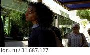 Купить «Couple interacting with each other at bus stop 4k», видеоролик № 31687127, снято 10 июня 2018 г. (c) Wavebreak Media / Фотобанк Лори