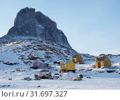 The fishing village Ikerasak during winter in the Uummannaq fjordsystem north of the polar circle. America, North America, Greenland, Denmark. Стоковое фото, фотограф Martin Zwick / age Fotostock / Фотобанк Лори