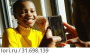 Купить «Man taking picture of woman on mobile phone 4k», видеоролик № 31698139, снято 8 сентября 2018 г. (c) Wavebreak Media / Фотобанк Лори