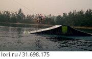 Купить «Man wakeboarding in the river 4k», видеоролик № 31698175, снято 22 августа 2018 г. (c) Wavebreak Media / Фотобанк Лори