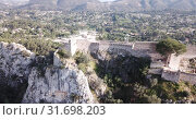 Купить «Picturesque aerial view of historic city of Xativa in spring day, Spain», видеоролик № 31698203, снято 16 апреля 2019 г. (c) Яков Филимонов / Фотобанк Лори