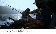 Купить «Two fishermen fishing in the river 4k», видеоролик № 31698335, снято 30 июля 2018 г. (c) Wavebreak Media / Фотобанк Лори