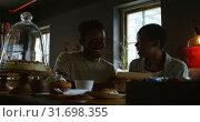 Купить «Couple looking at menu card in cafe 4k», видеоролик № 31698355, снято 8 сентября 2018 г. (c) Wavebreak Media / Фотобанк Лори