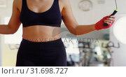 Купить «Female boxer exercising with skipping rope 4k», видеоролик № 31698727, снято 6 сентября 2018 г. (c) Wavebreak Media / Фотобанк Лори