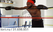 Купить «Male boxer relaxing in boxing ring 4k», видеоролик № 31698851, снято 6 сентября 2018 г. (c) Wavebreak Media / Фотобанк Лори