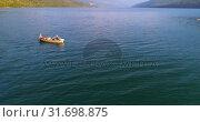 Купить «Tourists fishing on a boat in river 4k», видеоролик № 31698875, снято 30 июля 2018 г. (c) Wavebreak Media / Фотобанк Лори