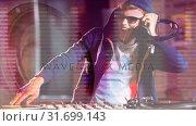 Купить «Digital animation showing smiling disco jockey mixing music in pub 4k», видеоролик № 31699143, снято 26 октября 2018 г. (c) Wavebreak Media / Фотобанк Лори