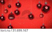 Купить «Digital animation of Christmas bauble against red background 4k», видеоролик № 31699167, снято 26 октября 2018 г. (c) Wavebreak Media / Фотобанк Лори