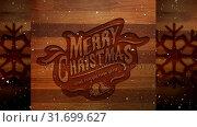 Купить «Video composition with snow over Christmas greeting on wood», видеоролик № 31699627, снято 2 ноября 2018 г. (c) Wavebreak Media / Фотобанк Лори