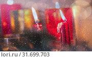 Купить «Candles and christmas decoration combined with falling snow», видеоролик № 31699703, снято 2 ноября 2018 г. (c) Wavebreak Media / Фотобанк Лори