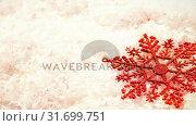 Купить «Christmas decoration combined with falling snow», видеоролик № 31699751, снято 2 ноября 2018 г. (c) Wavebreak Media / Фотобанк Лори