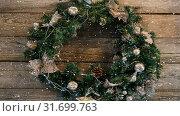 Купить «Falling snow with Christmas wreath decoration», видеоролик № 31699763, снято 2 ноября 2018 г. (c) Wavebreak Media / Фотобанк Лори