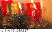Купить «Falling snow with Christmas candles», видеоролик № 31699827, снято 2 ноября 2018 г. (c) Wavebreak Media / Фотобанк Лори