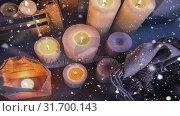 Купить «Falling snow with Christmas candles», видеоролик № 31700143, снято 2 ноября 2018 г. (c) Wavebreak Media / Фотобанк Лори