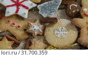 Купить «Falling snow with Christmas cookies decoration», видеоролик № 31700359, снято 2 ноября 2018 г. (c) Wavebreak Media / Фотобанк Лори