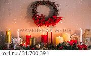 Купить «Falling snow with Christmas candles», видеоролик № 31700391, снято 2 ноября 2018 г. (c) Wavebreak Media / Фотобанк Лори