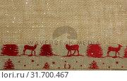Купить «Falling snow with Christmas reindeer textile», видеоролик № 31700467, снято 2 ноября 2018 г. (c) Wavebreak Media / Фотобанк Лори