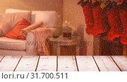 Купить «Blurred background of a living room decorated for christmas combined with falling snow», видеоролик № 31700511, снято 2 ноября 2018 г. (c) Wavebreak Media / Фотобанк Лори