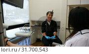 Купить «Female dentist interacting with a patient 4k», видеоролик № 31700543, снято 5 августа 2018 г. (c) Wavebreak Media / Фотобанк Лори