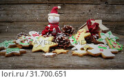 Купить «Video composition with falling snow over desk with ginger cookies and santa doll», видеоролик № 31700651, снято 2 ноября 2018 г. (c) Wavebreak Media / Фотобанк Лори
