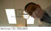 Купить «Male dentist examining a patient with tools 4k», видеоролик № 31700663, снято 5 августа 2018 г. (c) Wavebreak Media / Фотобанк Лори