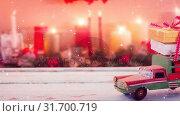 Купить «Model car with presents on its roof and blurred background of candles combined with falling snow», видеоролик № 31700719, снято 2 ноября 2018 г. (c) Wavebreak Media / Фотобанк Лори