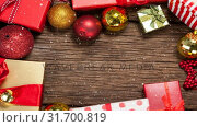 Купить «Falling snow with Christmas gifts», видеоролик № 31700819, снято 2 ноября 2018 г. (c) Wavebreak Media / Фотобанк Лори