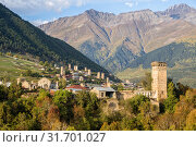 Купить «Scenic autumn view of Svan towers on a background of mountains, Mestia, Upper Svaneti, Georgia», фото № 31701027, снято 28 сентября 2018 г. (c) Юлия Бабкина / Фотобанк Лори