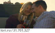 Купить «Happy couple having red wine in the balcony at home 4k», видеоролик № 31701327, снято 30 августа 2018 г. (c) Wavebreak Media / Фотобанк Лори