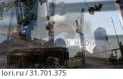 Купить «Construction site with falling gavel», видеоролик № 31701375, снято 6 ноября 2018 г. (c) Wavebreak Media / Фотобанк Лори