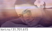 Купить «Relaxed smiling women with flower and sea landscape for valentine day 4k», видеоролик № 31701615, снято 6 ноября 2018 г. (c) Wavebreak Media / Фотобанк Лори