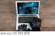 Купить «Digital animation of hackers hands on the laptop keyboard 4k», видеоролик № 31701875, снято 12 ноября 2018 г. (c) Wavebreak Media / Фотобанк Лори
